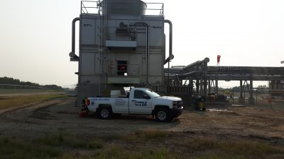exterior side view of the cross flow cooling tower, access door, platforms and ladders in view