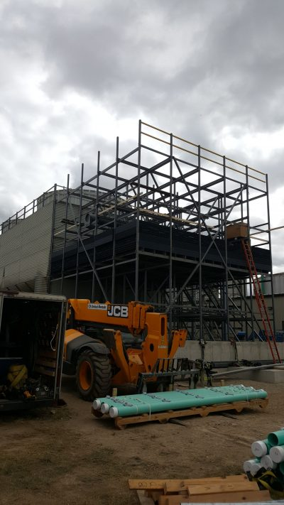 adding an additional cell to a field erected tower, metal framing erected and drift eliminators installed