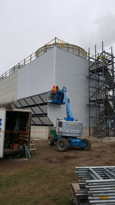 recently rebuilt field erected tower corner view with metal panels and louvers and fan