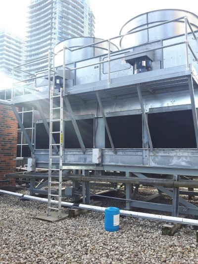 Exterior view of a induced draft counterflow tower with ladder and platform after repair