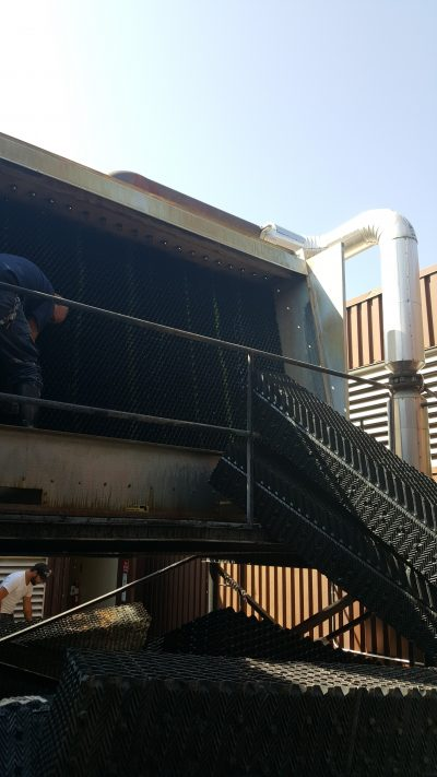CTM technicians installing fill into a cross flow tower