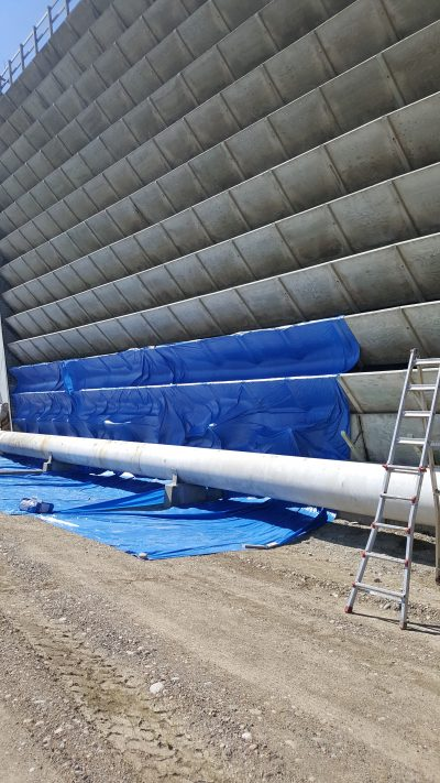 industrial tower repair, section of the pipe below the louvers painted white
