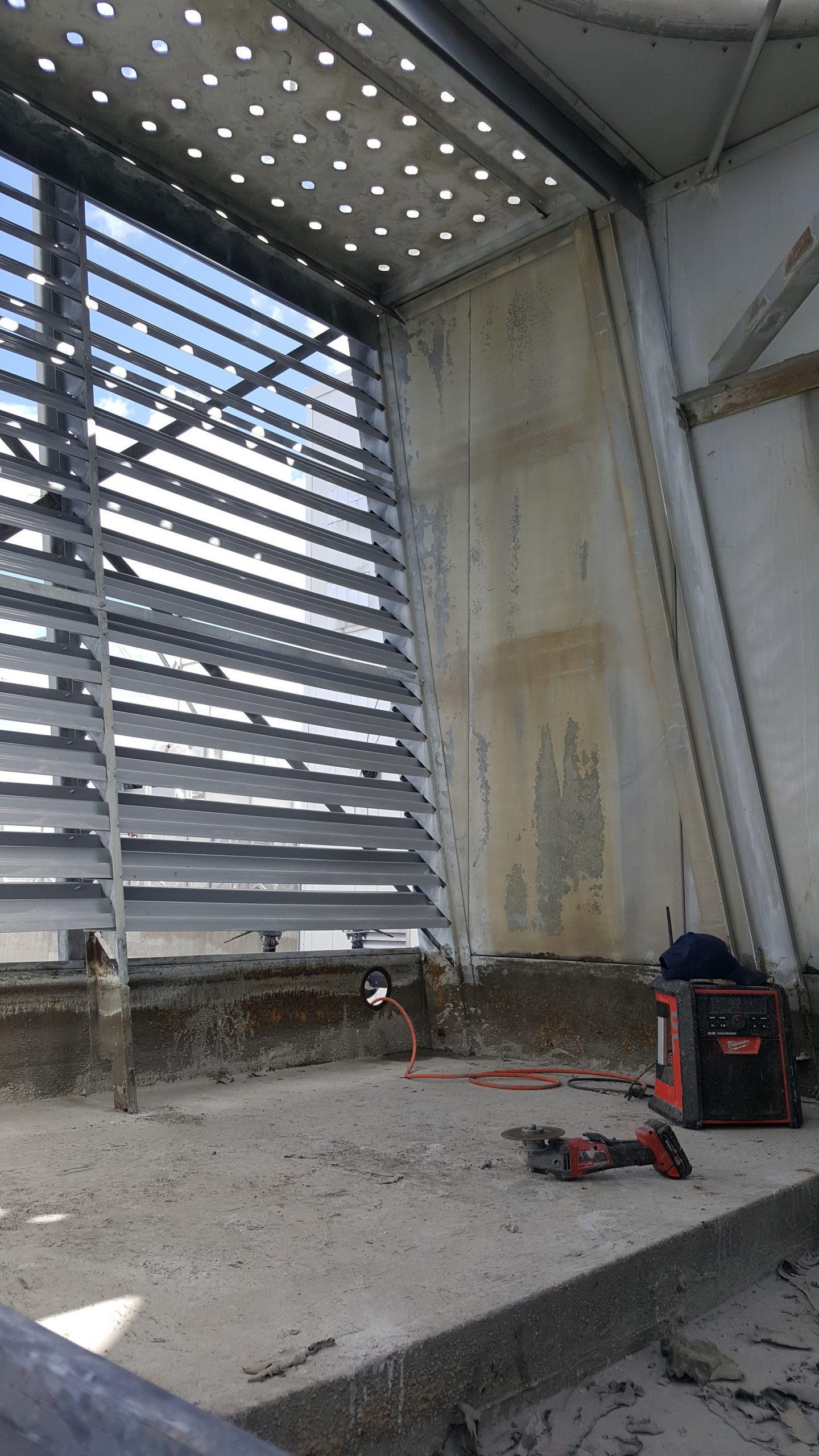 interior cross flow tower mid repair, part way through grinding