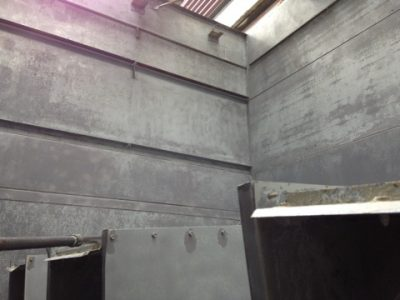 interior of counter flow cooling tower; after grinding and cleaning prior to caulking and painting