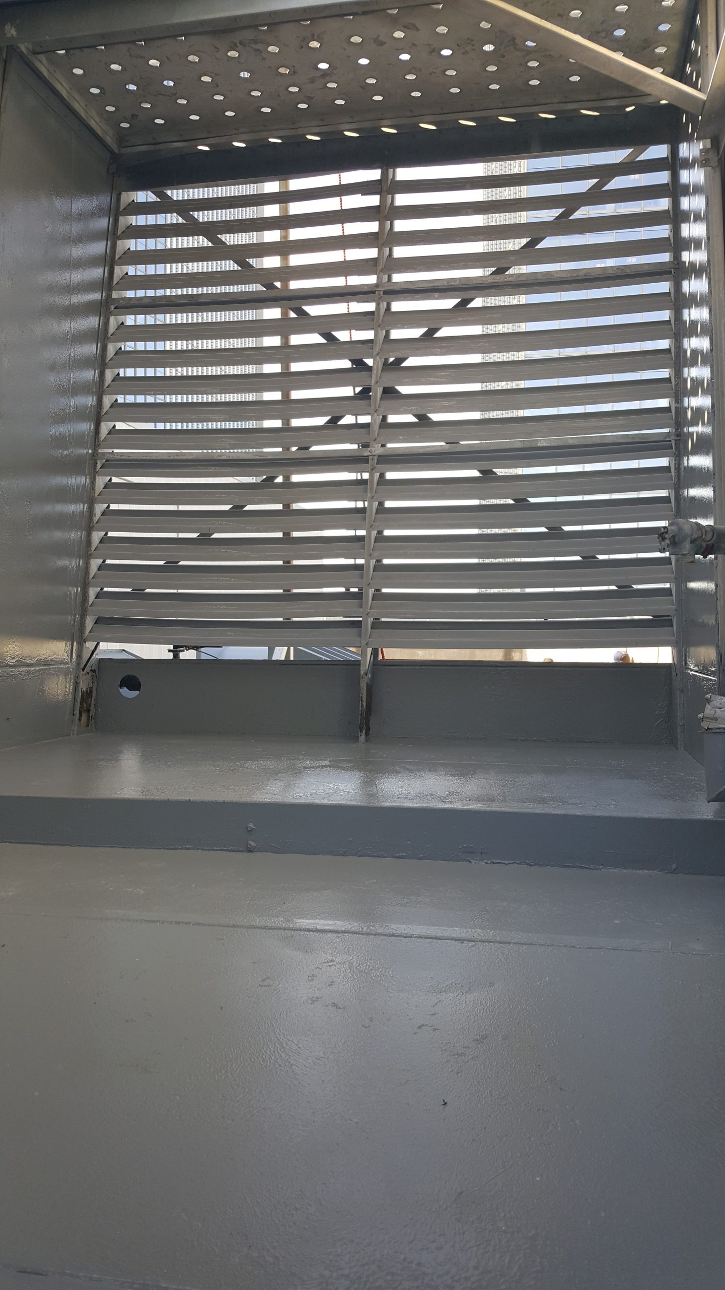interior of cross flow tower view of louvers and freshly epoxy painted floor and wall prior to installement of fill