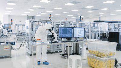 high tech lab, a scientist looking into a microscope
