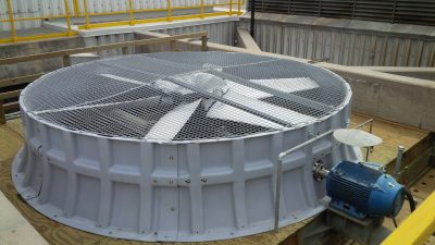 Crossflow tower close up of fan in casing and motor