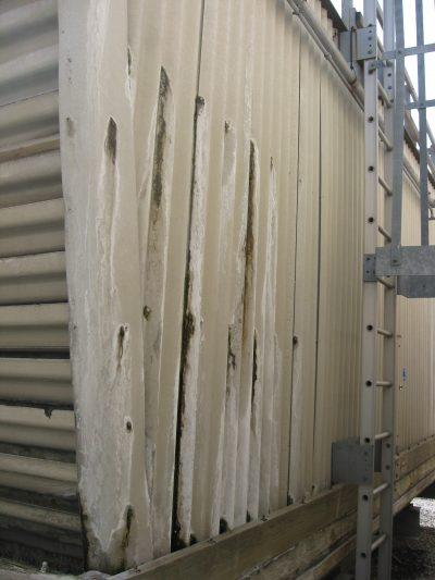 side view of older crossflow tower rusting side panel