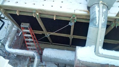 Cooling Tower exterior view of newly rebuilt frame with new fill in winter