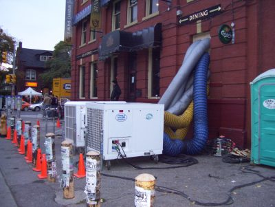 12 Ton Mobile AC with Duct work going in the window of a restaurant