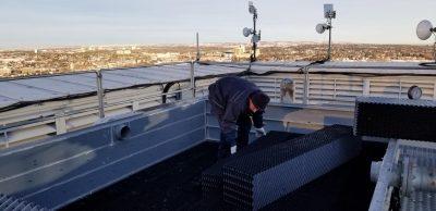 Drift eliminators being installed by a technician
