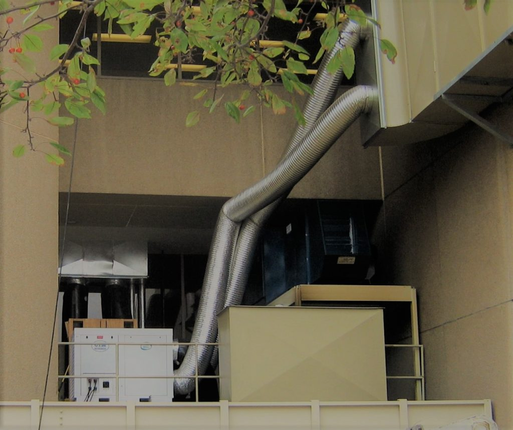 Portable Air Conditioner with ductwork going into a building